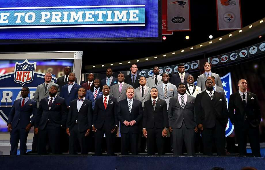 NFL Commissioner Roger Goodell poses for a group photo with the 2013 NFL Draft Class prior to the start of the first round of the 2013 NFL Draft at Radio City Music Hall on April 25, 2013 in New York City. Photo: Al Bello, Getty Images