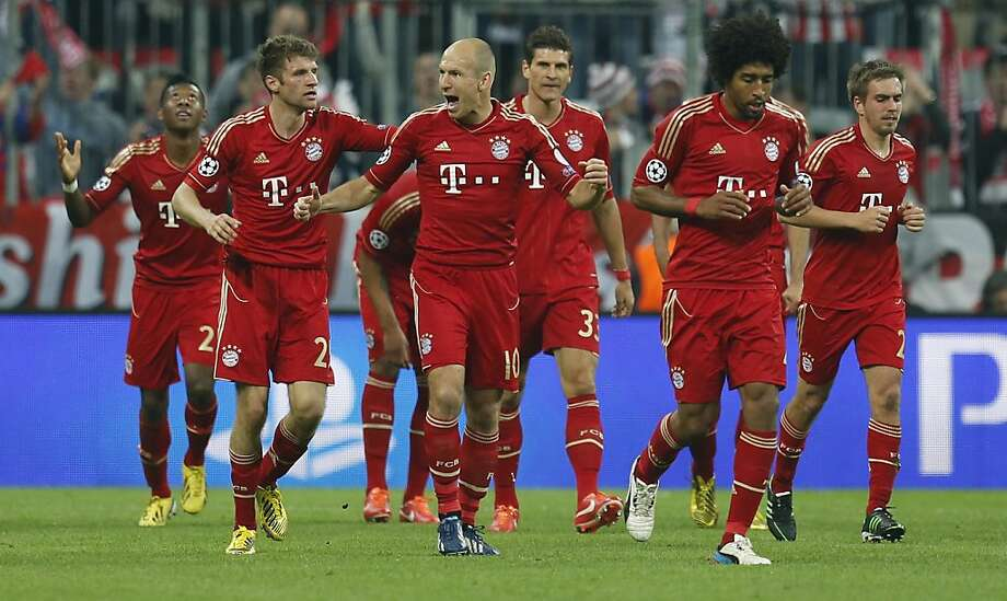 Similar to Arjen Robben (middle) after Thomas Mueller's goal against Barcelona, Bayern roared like a new king of the jungle. Photo: Matthias Schrader, Associated Press