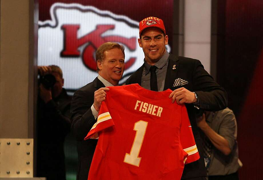 Eric Fisher of Central Michigan stands on stage with NFL Commissioner Roger Goodell after Fisher was picked #1 overall by the Kansas City Chiefs in the first round of the 2013 NFL Draft at Radio City Music Hall on April 25, 2013 in New York City.  Photo: Chris Chambers, Getty Images
