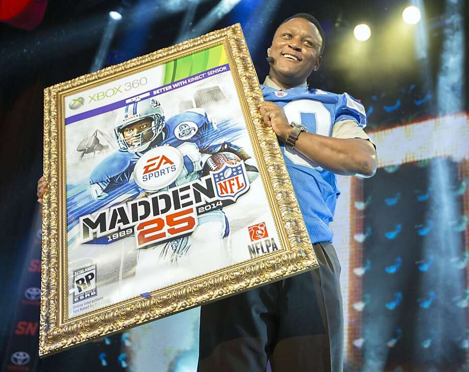IMAGE DISTRIBUTED FOR EA SPORTS - NFL hall of fame running back Barry Sanders holds up a mock up of the Madden 25 video game cover during the EA Sports Madden NFL 25 Cover Reveal on SportsNation on Wednesday, April, 24, 2013 in New York, New York. (Photo by Chris Park/Invision for EA Sports/AP Images) Photo: Chris Park, Associated Press