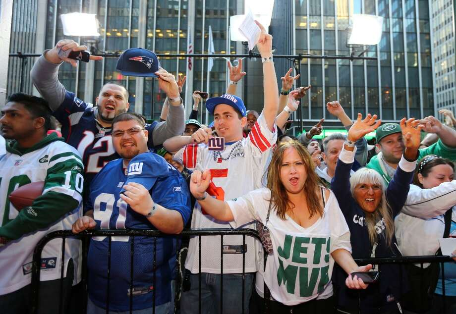 Spirited New York Giants and Jets fans cheer at the draft.