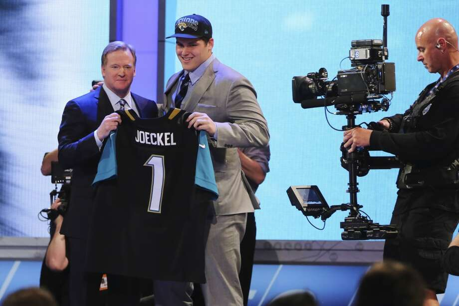 NFL commissioner Roger Goodell poses with No. 2 pick Luke Joeckel.