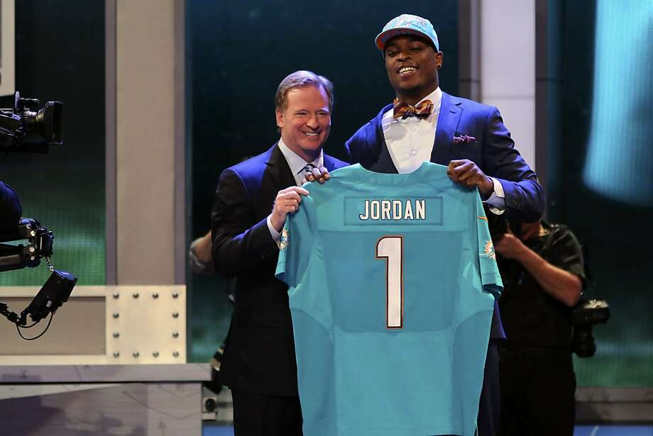 Dion Jordan, a defensive end from Oregon, stands with NFL Commissioner Roger Goodell after being selected third overall by the Miami Dolphins in the first round of the NFL football draft, Thursday, April 25, 2013, at Radio City Music Hall in New York. (AP Photo/Mary Altaffer) Photo: Mary Altaffer, Associated Press