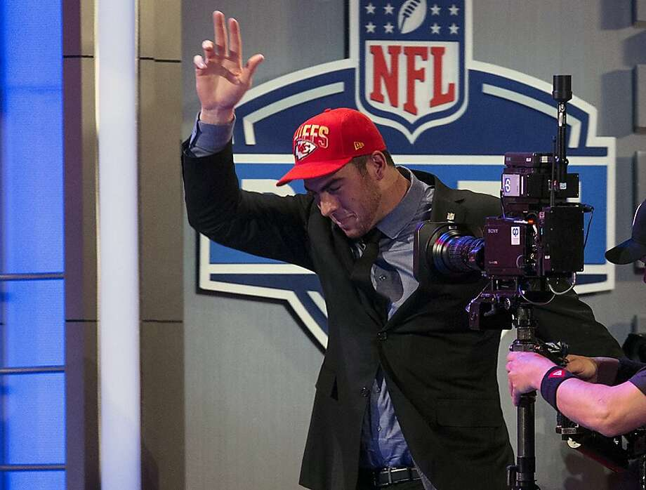 Eric Fisher from Central Michigan crosses the stage after being selected first overall by the Kansas City Chiefs during the first round of the NFL football draft, Thursday, April 25, 2013 at Radio City Music Hall in New York.(AP Photo/Craig Ruttle) Photo: Craig Ruttle, Associated Press