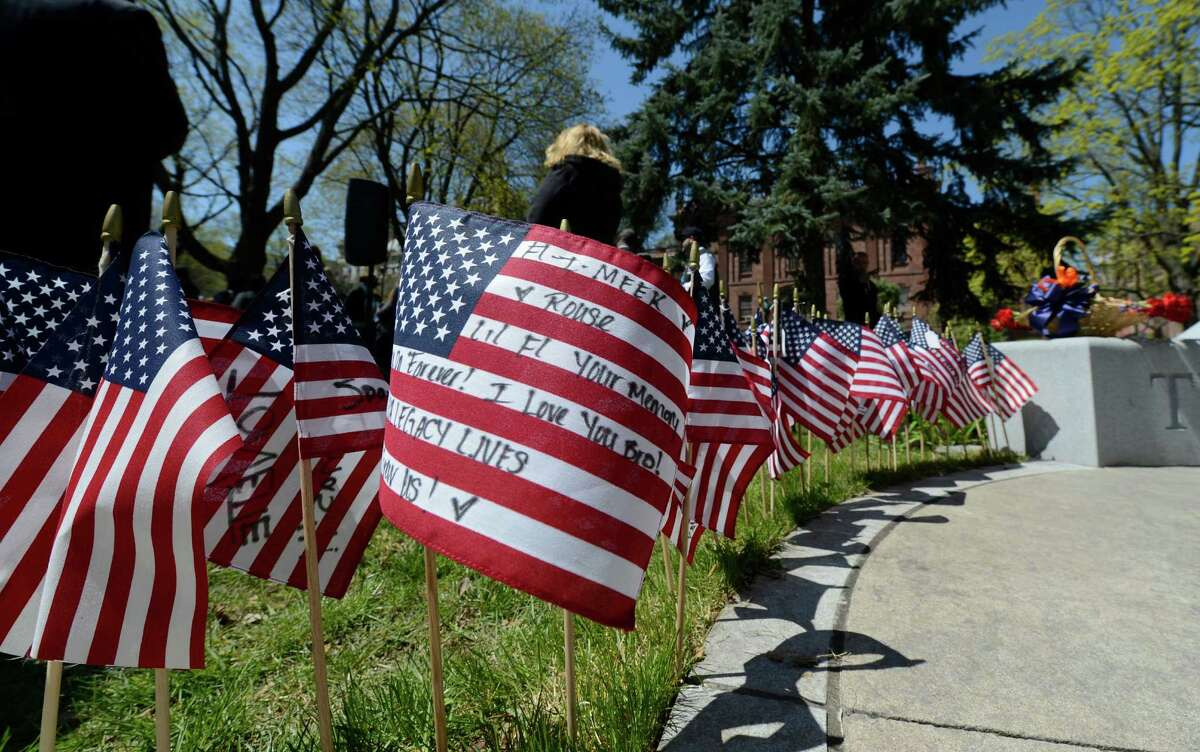 American flags with the names of crime victims were used as a memorial to crime victims at the Ceremony of Remembrance held at the Crime Victims Memorial April 25, 2013 in Academy Park in Albany, N.Y. (Skip Dickstein/Times Union)