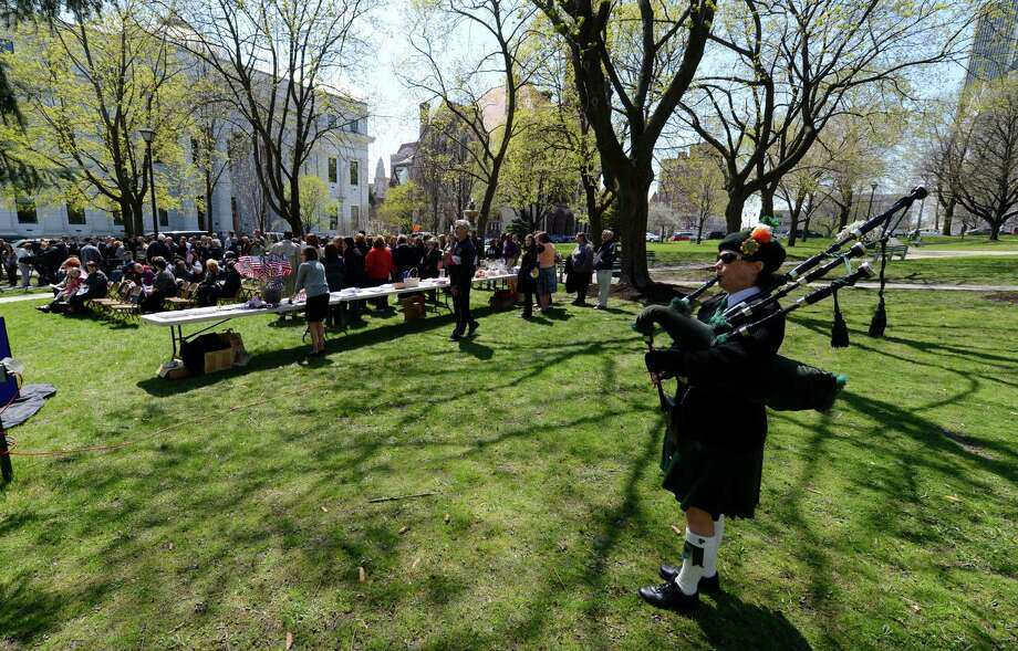 Piper Michelle Lyons Polito of the Sons & Daughters of Erin plays a bagpipe melody at the Ceremony of Remembrance held at the Crime Victims Memorial April 25, 2013 in Academy Park in Albany, N.Y.   (Skip Dickstein/Times Union) Photo: SKIP DICKSTEIN