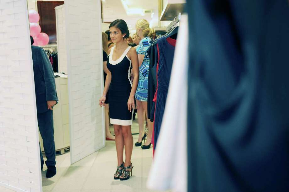 Melanie Borker, then a junior of Greenwich Academy, wears a Herve Leger dress during the Breast Cancer Alliance Junior Committee's spring fashion show last year at Richards of Greenwich. The event returns for its ninth year on Sunday, April 28, 2013,at the store and will again feature teen models, including Borker, who will don the latest fashions in an effort to raise funds and awareness. Photo: Helen Neafsey / Greenwich Time