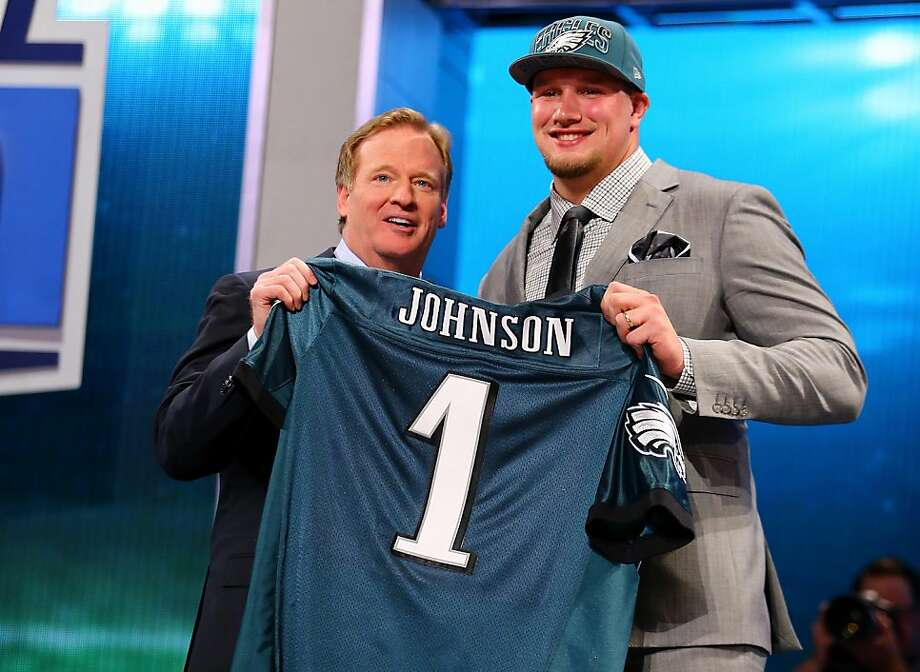 Lane Johnson of the Oklahoma Sooners stands with NFL Commissioner Roger Goodell (L) as they hold up a jersey on stage after Johnson was picked #4 overall by the Philadelphia Eagles in the first round of the 2013 NFL Draft at Radio City Music Hall on April 25, 2013 in New York City.  Photo: Al Bello, Getty Images