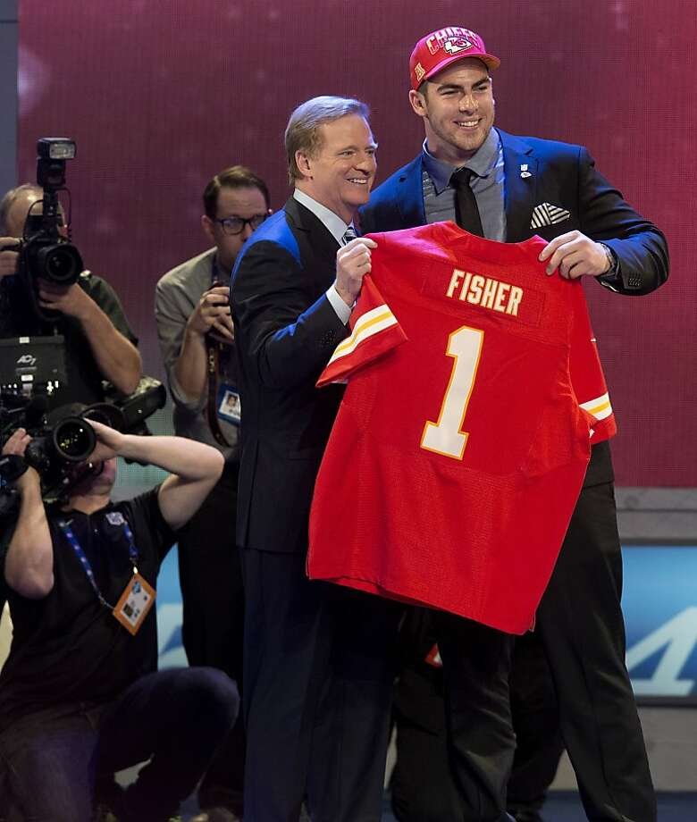 Tackle Eric Fisher, taken by the Chiefs with the top pick, stands with Commissioner Roger Goodell. Photo: Craig Ruttle, Associated Press
