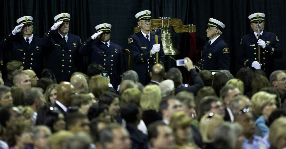 The Fire Department Honor Guard ring the final bell on Thursday April 25, 2013 at the Ferrell Center at Baylor University, for the fallen firefighter that were killed in the West explosion. Photo: Bob Owen, San Antonio Express-News / ©2013 San Antonio Express-News