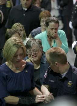 Family members of the fallen firefighter are overcome with emotion as the pass the coffins of the fire fighters that were killed in the West, TX explosion, on Thursday April 25, 2013 at the Ferrell Center at Baylor University. Photo: Bob Owen, San Antonio Express-News / ©2013 San Antonio Express-News