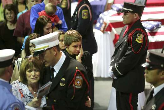 Fire Department Honor Guard from around the country stand next to coffins of the fire fighters that were killed in the West, TX explosion on Thursday April 25, 2013 at the Ferrell Center at Baylor University, where President Obama is scheduled to speak. Photo: Bob Owen, San Antonio Express-News / ©2013 San Antonio Express-News