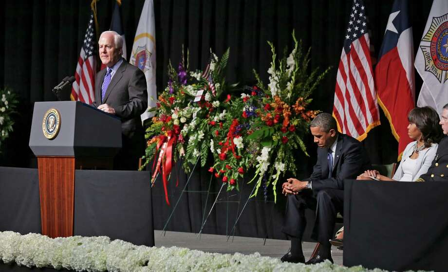 John Cornyn speaks of the fallen firefighters, on Thursday April 25, 2013, as President Barack Obama and his wife Michelle, right listen, during the memorial service for the first responders that were killed in the West explosion, at the Ferrell Center at Baylor University. Photo: Bob Owen, San Antonio Express-News / ©2013 San Antonio Express-News