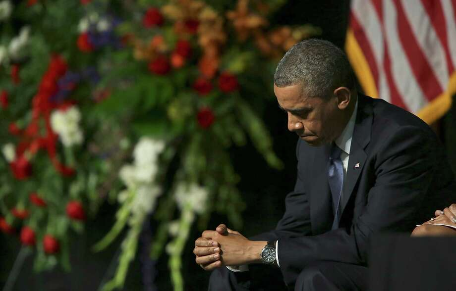 President Barack Obama in prayer on Thursday April 25, 2013 at the Ferrell Center at Baylor University, for the memorial serive for the fallen first responders in the explosion in West, TX. Photo: Bob Owen, San Antonio Express-News / ©2013 San Antonio Express-News
