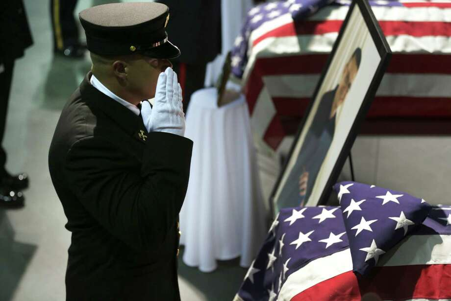 A Fire Department Honor Guard salutes a coffin of the fire fighter that was killed in the West, TX explosion, on Thursday April 25, 2013 at the Ferrell Center at Baylor University. Photo: Bob Owen, San Antonio Express-News / ©2013 San Antonio Express-News