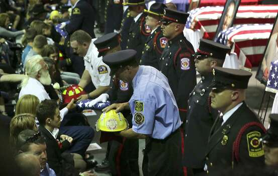 Fire Department Honor Guard present flags and the helmets of the fallen first responders from the blast in West, TX. to family members on Thursday April 25, 2013 at the Ferrell Center at Baylor University. Photo: Bob Owen, San Antonio Express-News / ©2013 San Antonio Express-News