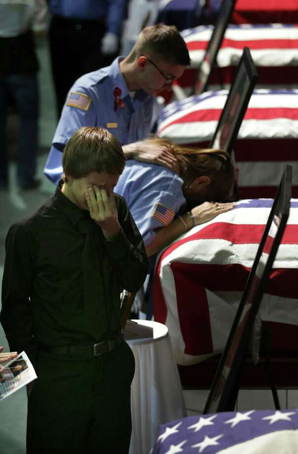 Family members of the fallen fire fighters killed in the West, TX explosion grieve for their loved ones at the memorial service for the first responders on Thursday April 25, 2013 at the Ferrell Center at Baylor University. Photo: Bob Owen, San Antonio Express-News / ©2013 San Antonio Express-News