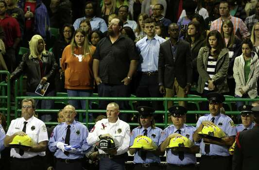 Member of Fire Departments carry the helmets of the fallen firefighters in the Memorial Service for those killed in the line of duty in West, TX,  on Thursday April 25, 2013 at the Ferrell Center at Baylor University, where President Obama spoke. Photo: Bob Owen, San Antonio Express-News / ©2013 San Antonio Express-News