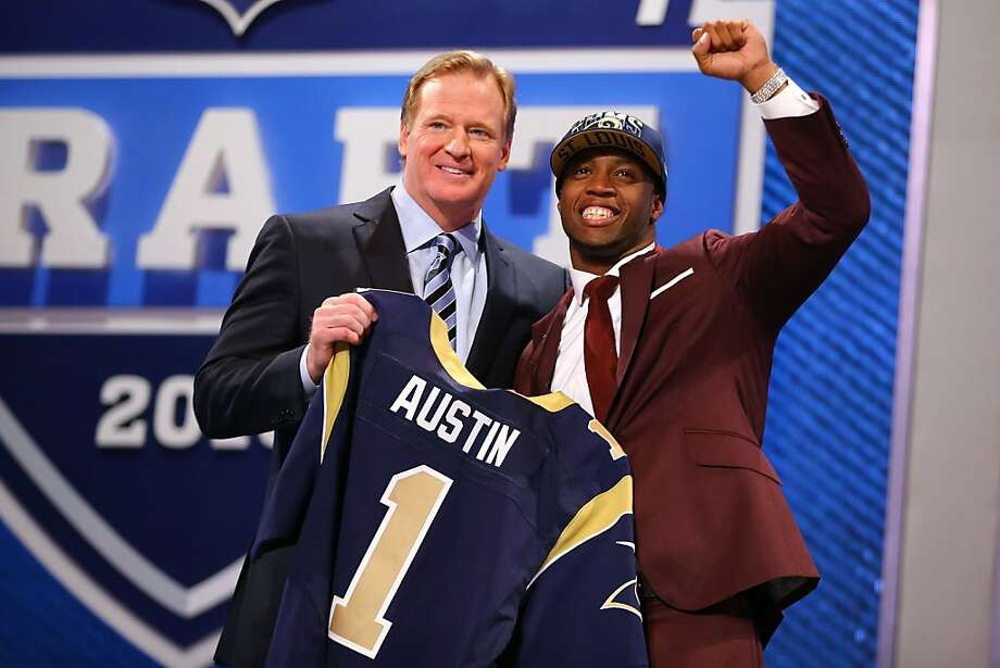 Tavon Austin of West Virginia reacts with NFL Commissioner Roger Goodell as they hold up a jersey on stage after Austin was picked #8 overall by the St. Louis Rams in the first round of the 2013 NFL Draft at Radio City Music Hall on April 25, 2013 in New York City. Photo: Al Bello, Getty Images