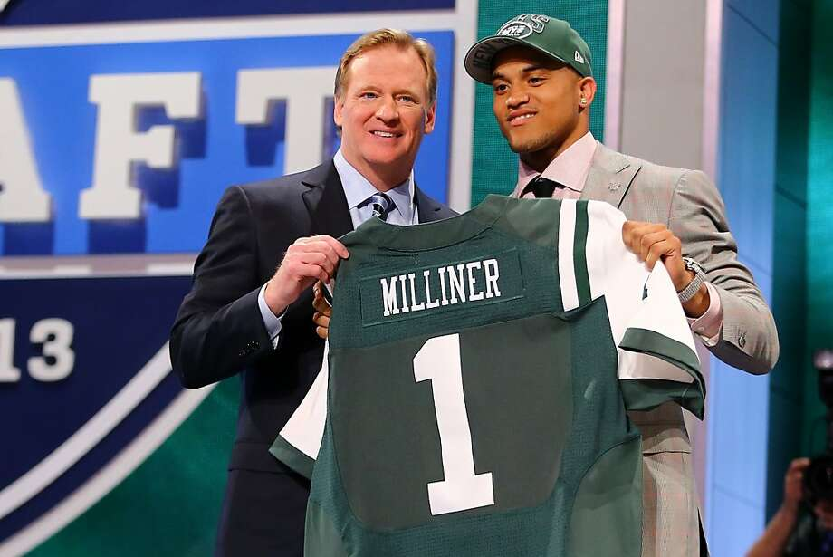 Dee Milliner of the Alabama Crimson Tide stands with NFL Commissioner Roger Goodell as they hold up a jersey on stage after Milliner was picked #9 overall by the New York Jets in the first round of the 2013 NFL Draft at Radio City Music Hall on April 25, 2013 in New York City. Photo: Al Bello, Getty Images