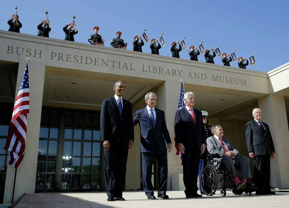 From left, President Barack Obama, former president George W. Bush, former president William J. Clinton, former President George H.W. Bush and former president Jimmy Carter arrive for the dedication of the George W. Bush Presidential Center on Thursday in Dallas. Photo: David J. Phillip, STF / AP