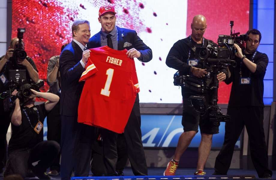 NFL commissioner Roger Goodell poses with No. 1 pick Eric Fisher.