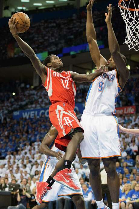 Patrick Beverley, left, was undaunted by the playoff atmosphere, taking it to Serge Ibaka and the Thunder. Photo: Smiley N. Pool, Staff / © 2013  Houston Chronicle