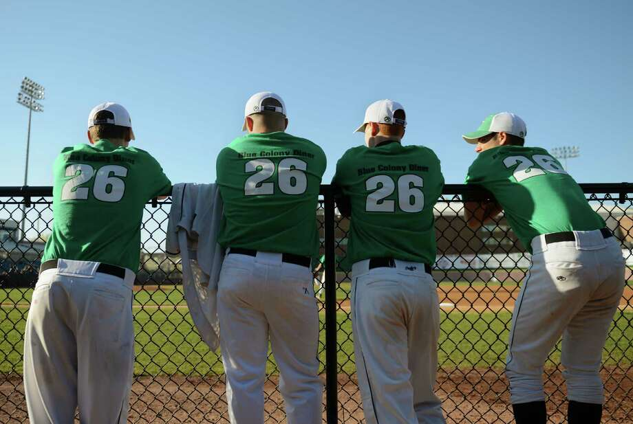 """Pomperaug players wear a special Sandy Hook shirt for warm-ups to remember the 26 victims of the shooting at Sandy Hook Elementary School before Newtown's 5-4 win over Pomperaug in the baseball """"Game to Remember"""" at The Ballpark at Harbor Yard in Bridgeport, Conn. on Thursday, April 25, 2013.  The game was played to honor and acknowledge Sandy Hook Elementary School and the first responders of the December 14 tragedy.  All proceeds benefitted the Sandy Hook Volunteer Fire Department. Photo: Tyler Sizemore / The News-Times"""