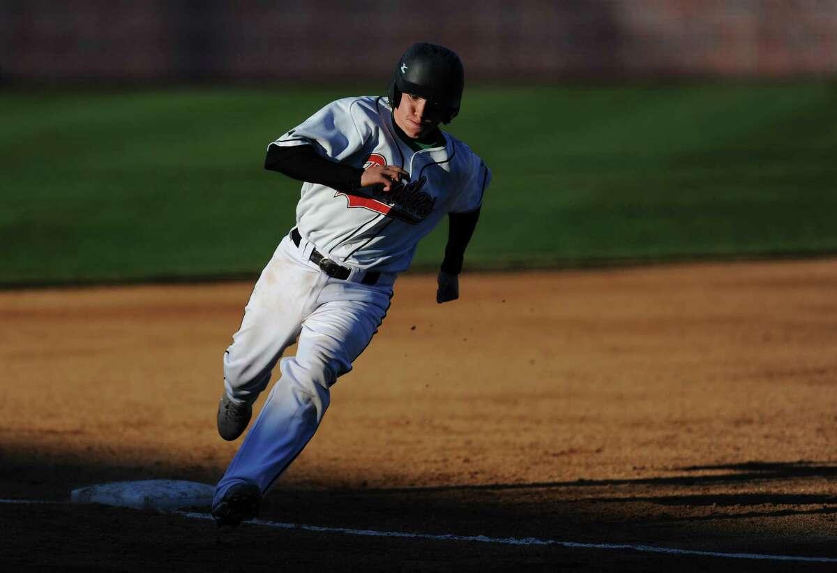 Pomperaug's Steve Harrison rounds third base during Newtown's 5-4 win over Pomperaug in the baseball