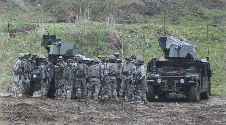 U.S. soldiers gather around their vehicles Thursday during exercises in Paju, South Korea, near the border with North Korea. The joint exercises have taken place annually for years. Photo: Ahn Young-joon / Associated Press