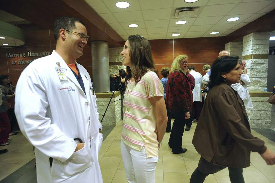 Dr. Jorge Alvarez (left), a cardiologist with the Cardiology Clinic of San Antonio, talks with his wife, Becky, after a ceremony in which he was honored for assisting the wounded after the bombings at the Boston Marathon. Photo: Billy Calzada / San Antonio Express-News