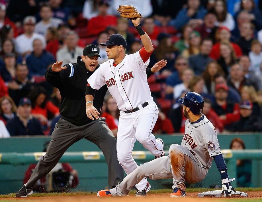 Marwin Gonzalez of the Astros beats a throw to third base against Will Middlebrooks of the Red Sox.
