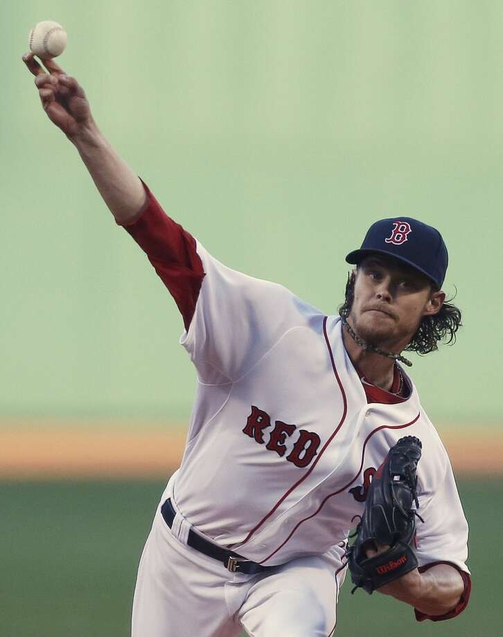 Red Sox pitcher Clay Bucholz throws against the Astros.
