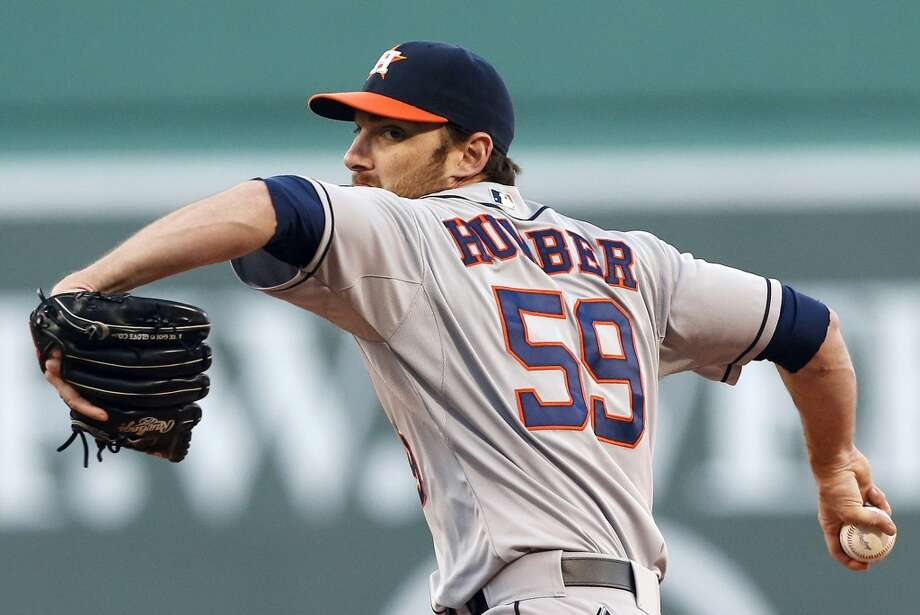 Philip Humber of the Astros delivers a pitch against the Red Sox. Photo: Michael Dwyer, Associated Press
