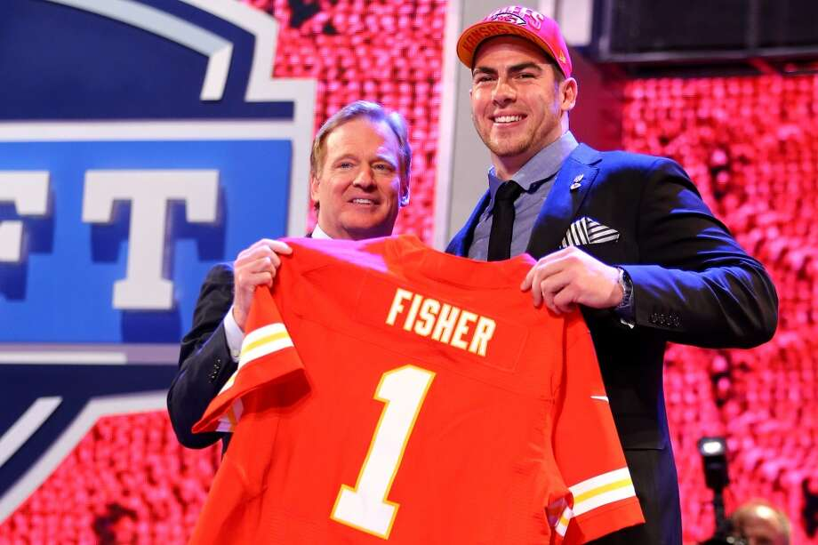 Eric Fisher of Central Michigan stands on stage with NFL Commissioner Roger Goodell after Fisher was picked #1 overall by the Kansas City Chiefs in the first round of the 2013 NFL Draft at Radio City Music Hall on April 25, 2013 in New York City.