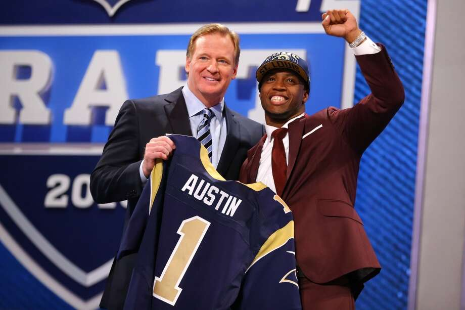 Tavon Austin of West Virginia Mountaineers reacts with NFL Commissioner Roger Goodell as they hold up a jersey on stage after Austin was picked #8 overall by the St. Louis Rams in the first round of the 2013 NFL Draft at Radio City Music Hall on April 25, 2013 in New York City.