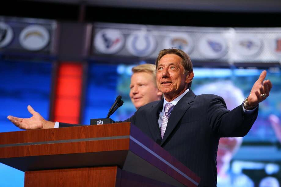 Former New York Giants quarterback Phil Simms and former New York Jets quarterback Joe Namath appear on stage during the first round of the 2013 NFL Draft at Radio City Music Hall on April 25, 2013 in New York City.