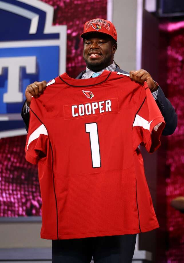 Jonathan Cooper of North Carolina Tar Heels holds up a jersey on stage after he was picked #7 overall by the Arizona Cardinals.