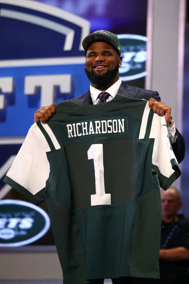 Sheldon Richardson of the Missouri Tigers holds up a jersey on stage after he was picked #13 overall by the New York Jets in the first round of the 2013 NFL Draft at Radio City Music Hall on April 25, 2013 in New York City.