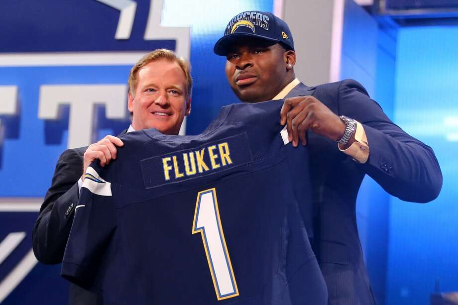 NEW YORK, NY - APRIL 25:  D.J. Fluker of the Alabama Crimson Tide stands with NFL Commissioner Roger Goodell (L) as they hold up a jersey on stage after Fluker was picked #11 overall by the San Diego Chargers in the first round of the 2013 NFL Draft at Radio City Music Hall on April 25, 2013 in New York City.  (Photo by Al Bello/Getty Images)