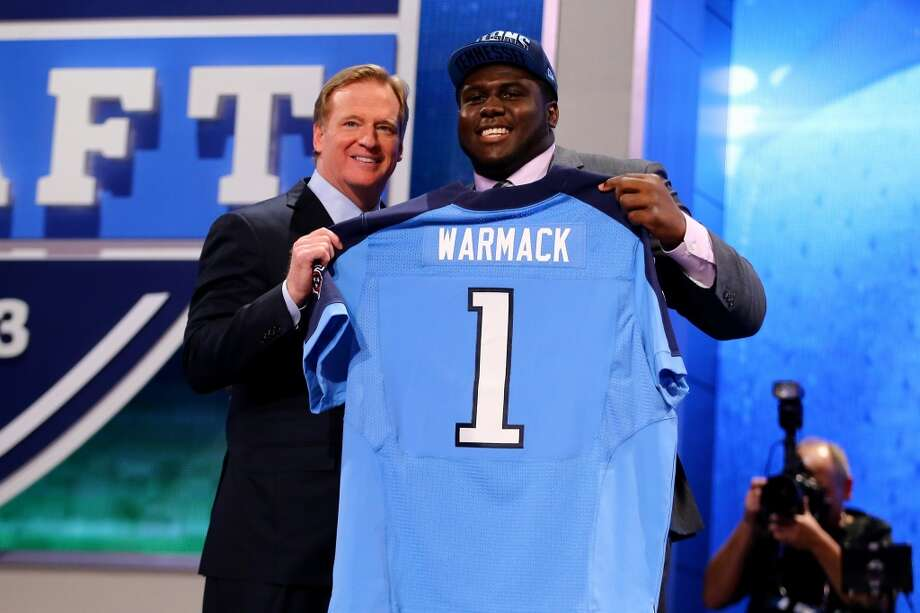 NEW YORK, NY - APRIL 25:  Chance Warmack of the Alabama Crimson Tide stands on stage with NFL Commissioner Roger Goodell (L) as they hold up a jersey on stage after he was picked #10 overall by the Tennessee Titans in the first round of the 2013 NFL Draft at Radio City Music Hall on April 25, 2013 in New York City.  (Photo by Al Bello/Getty Images)
