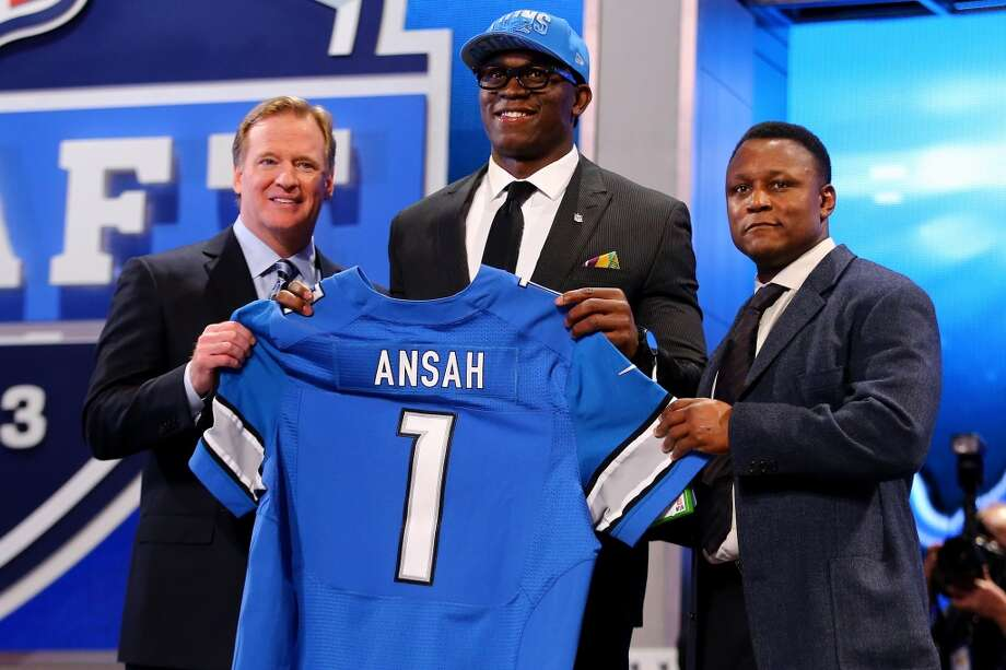 Ezekiel Ansah of the BYU Cougars stands with NFL Commissioner Roger Goodell (L) and Pro Football Hall of Famer Barry Sanders (R) as they hold up a jersey on stage after Ansah was picked #5 overall by the Detroit Lions in the first round of the 2013 NFL Draft at Radio City Music Hall on April 25, 2013 in New York City.