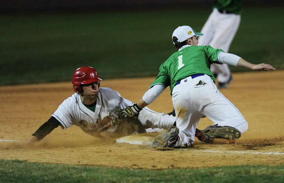 "Newtown's Justin Devellis tags out a Pomperaug baserunner during Newtown's 5-4 win over Pomperaug in the baseball ""Game to Remember"" at The Ballpark at Harbor Yard in Bridgeport, Conn. on Thursday, April 25, 2013.  The game was played to honor and acknowledge Sandy Hook Elementary School and the first responders of the December 14 tragedy.  All proceeds benefitted the Sandy Hook Volunteer Fire Department. Photo: Tyler Sizemore / The News-Times"