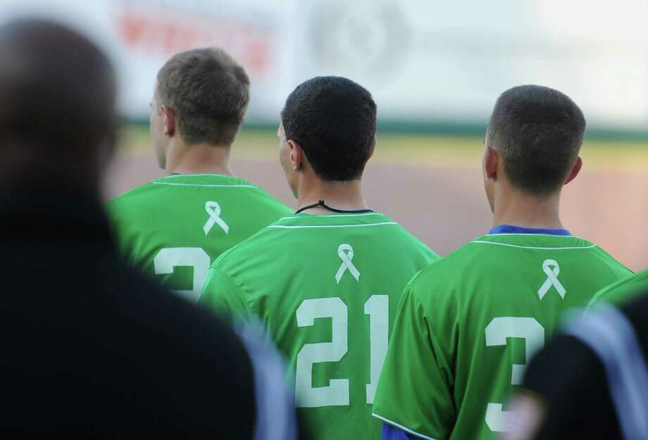 "Newtown players wear special Sandy Hook jerseys during Newtown's 5-4 win over Pomperaug in the baseball ""Game to Remember"" at The Ballpark at Harbor Yard in Bridgeport, Conn. on Thursday, April 25, 2013.  The game was played to honor and acknowledge Sandy Hook Elementary School and the first responders of the December 14 tragedy.  All proceeds benefitted the Sandy Hook Volunteer Fire Department. Photo: Tyler Sizemore / The News-Times"