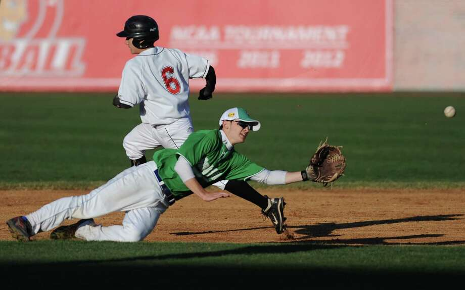 "Newtown's Justin Devellis dives for a ball as Pomperaug's Carl Gatzendorfer rounds second base during Newtown's 5-4 win over Pomperaug in the baseball ""Game to Remember"" at The Ballpark at Harbor Yard in Bridgeport, Conn. on Thursday, April 25, 2013.  The game was played to honor and acknowledge Sandy Hook Elementary School and the first responders of the December 14 tragedy.  All proceeds benefitted the Sandy Hook Volunteer Fire Department. Photo: Tyler Sizemore / The News-Times"