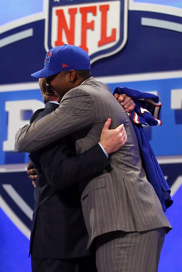 NEW YORK, NY - APRIL 25:  E.J. Manuel of the Florida State Seminoles greets NFL Commissioner Roger Goodell after Manuel was picked #16 overall by the Buffalo Bills in the first round of the 2013 NFL Draft at Radio City Music Hall on April 25, 2013 in New York City.  (Photo by Al Bello/Getty Images) Photo: Al Bello, Getty Images