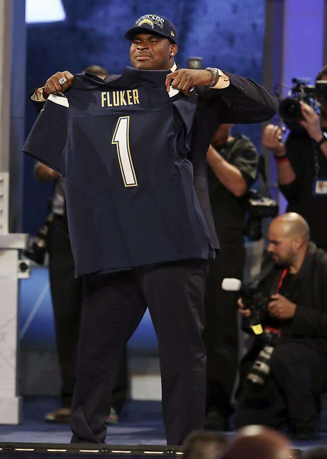 D.J. Fluker, from Alabama, holds up a team jersey after being selected 11th overall by the San Diego Chargers in the first round of the NFL football draft, Tuesday, April 23, 2013, at Radio City Music Hall in New York. (AP Photo/Gregory Payan) Photo: Gregory Payan, Associated Press
