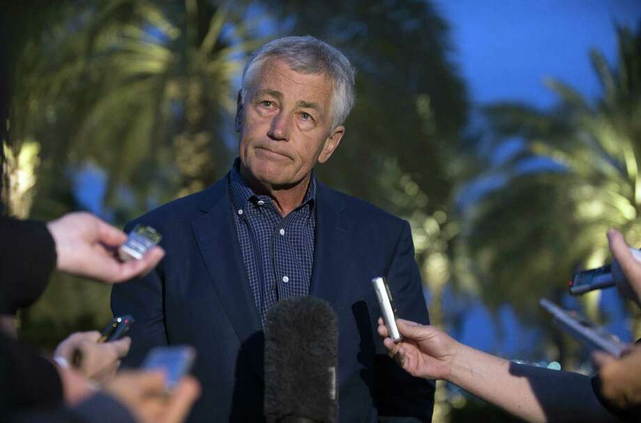 U.S. Secretary of Defense Chuck Hagel speaks with reporters after reading a statement on chemical weapon use in Syria during a press conference in Abu Dhabi, United Arab Emirates on Thursday, April 25, 2013. (AP Photo/Jim Watson, Pool) Photo: Jim Watson