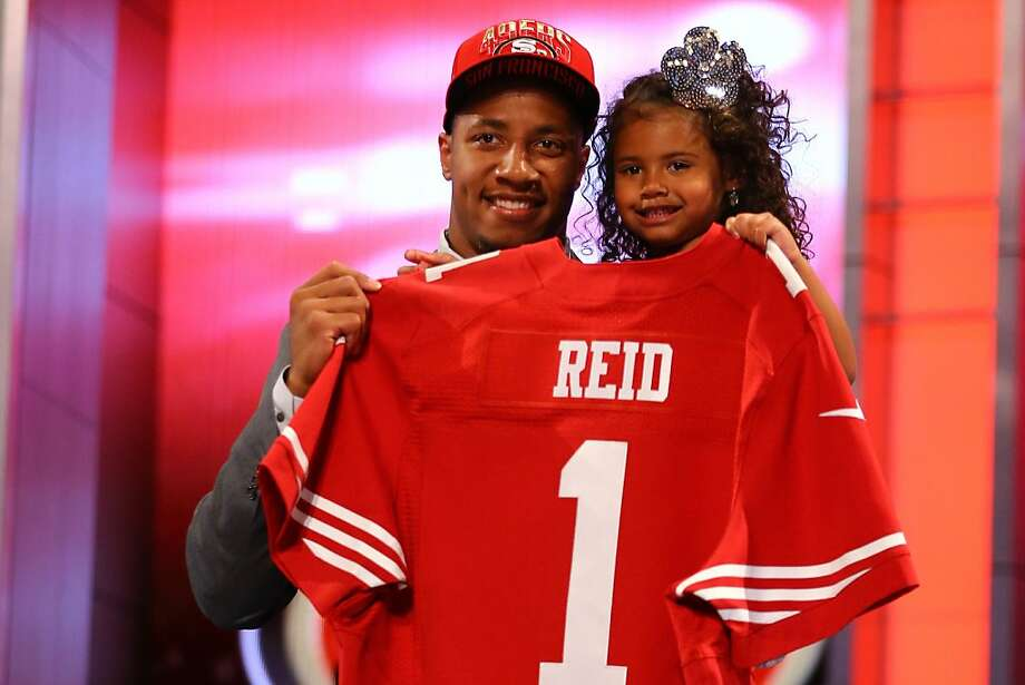 NEW YORK, NY - APRIL 25:  Eric Reid of the LSU Tigers holds his daughter Eric Reid of the LSU Tigers as they hold up a jersey on stage after he was picked #18 overall by the San Francisco 49ers in the first round of the 2013 NFL Draft at Radio City Music Hall on April 25, 2013 in New York City.  (Photo by Al Bello/Getty Images) Photo: Al Bello, Getty Images
