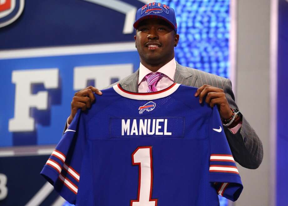 E.J. Manuel of the Florida State Seminoles holds up a jersey on stage after he was picked #16 overall by the Buffalo Bills.